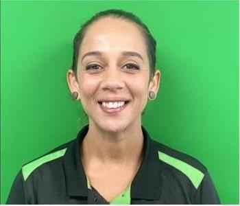 image of female smiling against green background