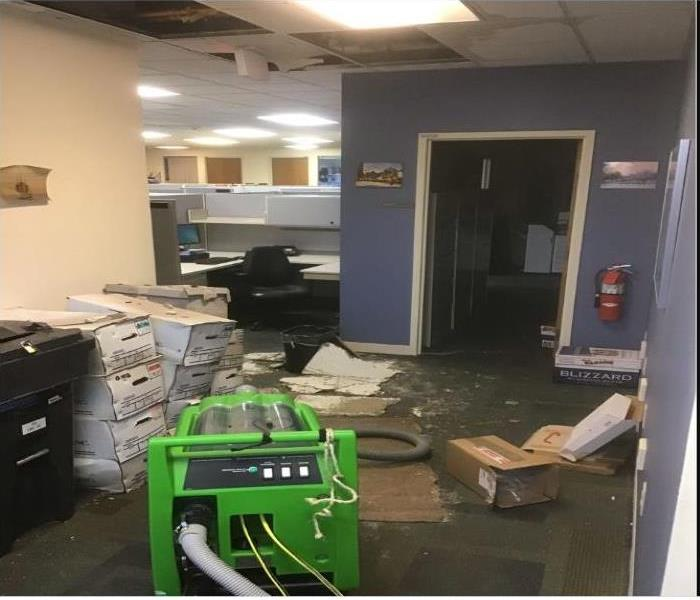 files and ceiling damaged by water in office building